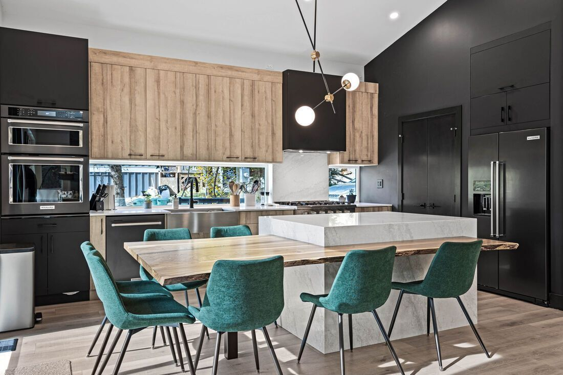 kitchen and table with green chairs
