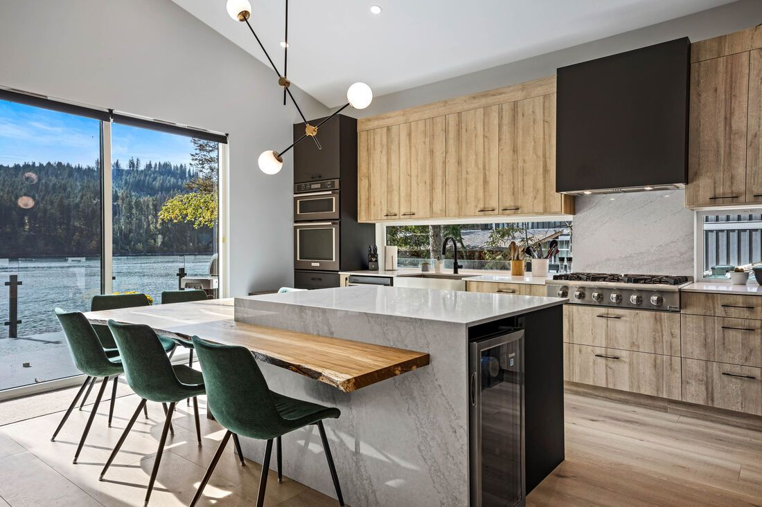 kitchen island with green chairs