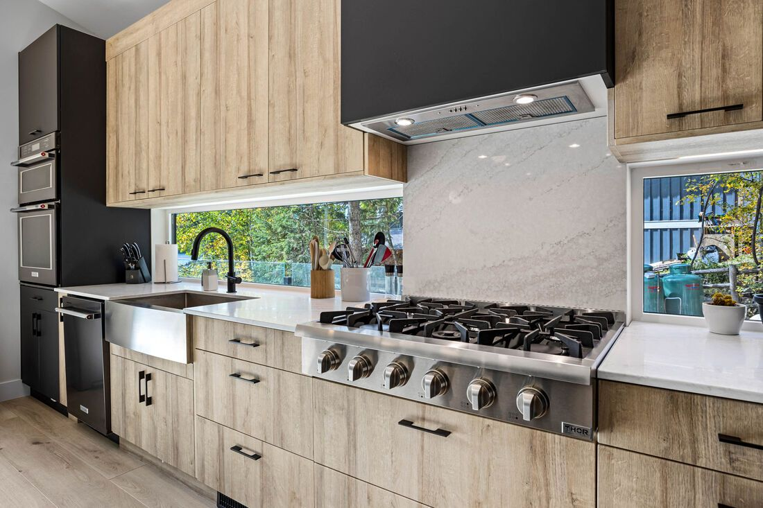 gas stove countertops and cupboards in a new kitchen