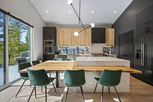 interior designed kitchen with island and green chairs